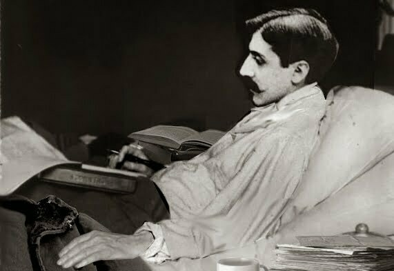 Marcel Proust working in bed